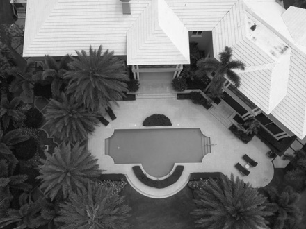 Aerial view of large home with rectangular pool - photo black and white