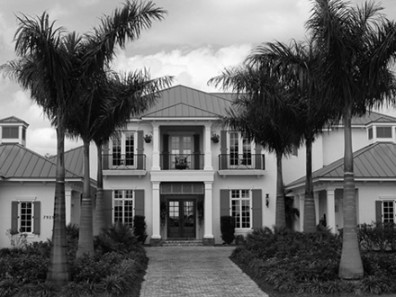 Large 2 story house in black and white photo